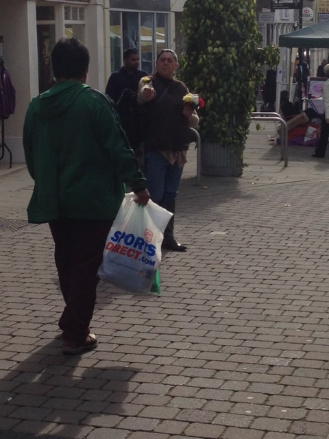 Women selling flowers in Andover Town Centre