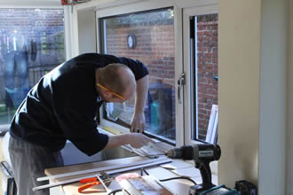 KJM Windows and Conservatories fit new windows